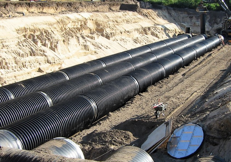 Piping laying in engineered dirt ditch